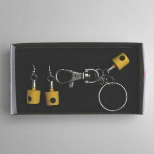 New York Fat Cap Ohrring Und Schlüsselanhänger (Yellow) By Busta 170